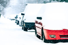 Parked Cars on a Snowstorm Winter Day Stock Photo
