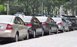 Parked cars beside the street Royalty Free Stock Photo