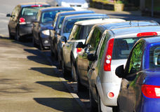 Parked cars in street Stock Photography