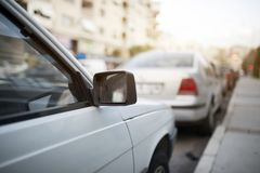 Parked Cars At Street. Parked cars at roadside city street royalty free stock photography