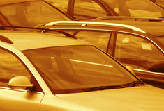 Parked cars toned brown. Telephoto view of cars parked in parking lot (toned brown Stock Photo