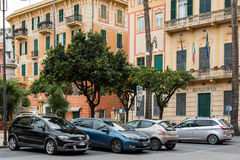Parked cars under citrus trees in Santa Margherita Ligure, Italy Royalty Free Stock Photo