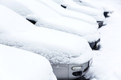 Parked cars in winter Stock Images