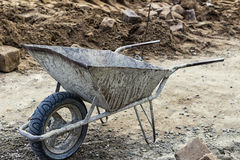 Parked empty wheelbarrow for construction Royalty Free Stock Photography