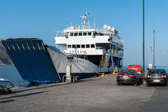 Parked ferry is staying near pier of Paleochora town. Stock Photography