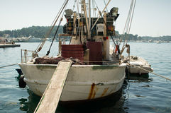 Parked fishing boat Stock Photos