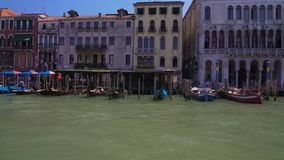 Parked gondolas and vaporettos, view of tour boats along Grand Canal in Venice. Stock footage stock footage