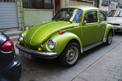 Parked Green Classic Beetle Stock Photo