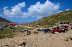 Parked jeeps in mountains around Lake Saiful Muluk North Pakistan Royalty Free Stock Image