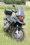 Parked large black BMW motorbike on green grass. Rustenburg, South Africa - March 3, 2017: Parked large black BMW motorbike on green grass at Yearly Mass Ride of Stock Photo
