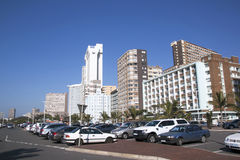Parked motor vehicles and Buildings on Beachfront Stock Images