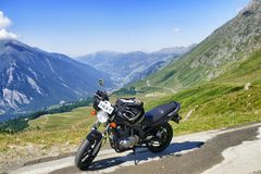 Parked motorbike on panoramic mountain view stock photos