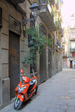 Parked motorbike in the street in Ciutat Vella Old Town in Barcelona Royalty Free Stock Photo