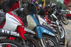 Parked motorbikes in Asian city Stock Images