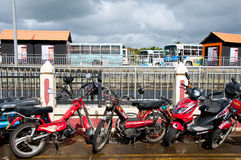 Parked motorbikes and buses Royalty Free Stock Photography
