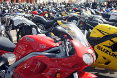 Parked motorbikes in a festival Stock Image