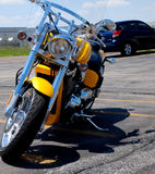 Parked Motorcycle. This is a front view, of a yellow parked motorcycle Royalty Free Stock Photos
