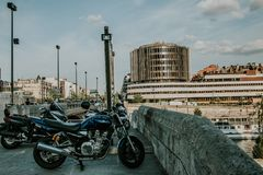 Parked Motorcycle on Gray Concrete Floor stock photography
