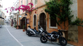 Parked motorcycles in the old town of Rethymno Stock Photo