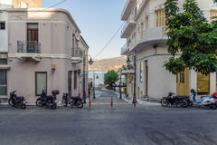 Parked motorcycles at street of Sita town on Crete island, Greece Royalty Free Stock Photo