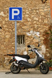 Parked old moped. An old moped parked next to a parking sign Royalty Free Stock Photography
