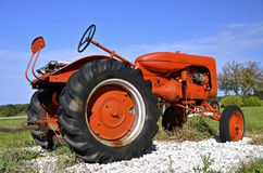 Parked old orange tractor Royalty Free Stock Image
