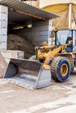 Parked pay loader near pile of dirt Stock Photography