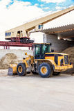 Parked pay loader near pile of dirt Stock Image