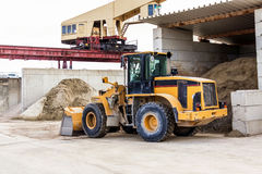 Parked pay loader near pile of dirt Stock Photo