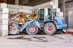 Parked pay loader near pile of dirt Stock Photos