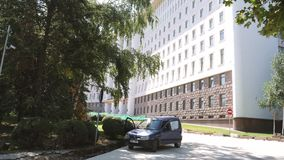 Parked Peugeot car near the Parliament of Moldova. Chisinau, Moldova - Circa 2018: Parked Peugeot car near the Parliament of Moldova building on a warm summer stock video footage