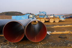Parked pipe transporting trucks Royalty Free Stock Image