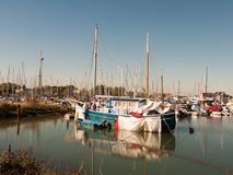 Parked private boat in front of harbour marina scene masts royalty free stock image