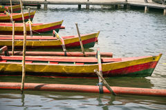 Parked red boats. Parked red boats at Danu Ulun Bratan Temple lake stock photography