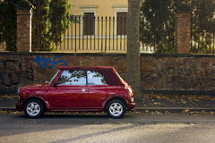 Parked red car on the streets of Rome Stock Image