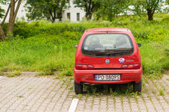 Parked Red Fiat Seicento stock photography