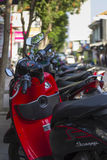 Parked red Honda Scoopy scooters Bali. Stock Image
