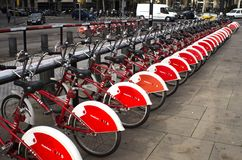 Parked Red and White Bicycles Stock Photos