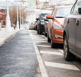 Parked in a row cars. On the roadway of the city street Royalty Free Stock Photo