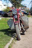 Parked at the lawn old red motorcycle royalty free stock photo