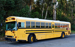Parked School Bus. Side and front view of parked school bus in parking lot Royalty Free Stock Photography