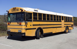 Parked School Bus. Yellow-orange school bus parked in lot. Nobody Royalty Free Stock Photography