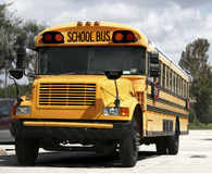 Parked schoolbus. Schoolbus parked in a parking lot Royalty Free Stock Photos