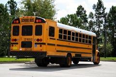Parked schoolbus rearAa Royalty Free Stock Photos