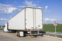 Parked Semi-Truck. White Semi-Truck parked in forbidden spot Stock Images