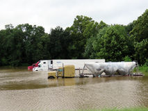 Parked semi trucks and trailers in flood waters Stock Photos