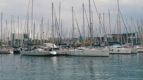 Parked Ships, Boats, Yachts in Rambla del Mar Port of Barcelona, Spain. stock video