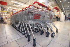 Parked shopping carts. In a supermarket Stock Image
