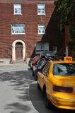 Parked taxi. A row of parked cars on a quiet residential street with a retro look Stock Images