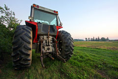 Parked tractor. A tractor parked on farmer's land Stock Photography